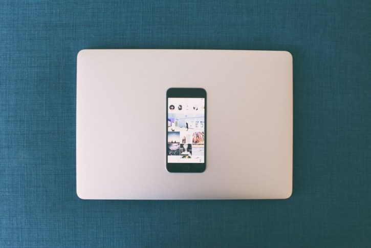 laptop image with phone on top